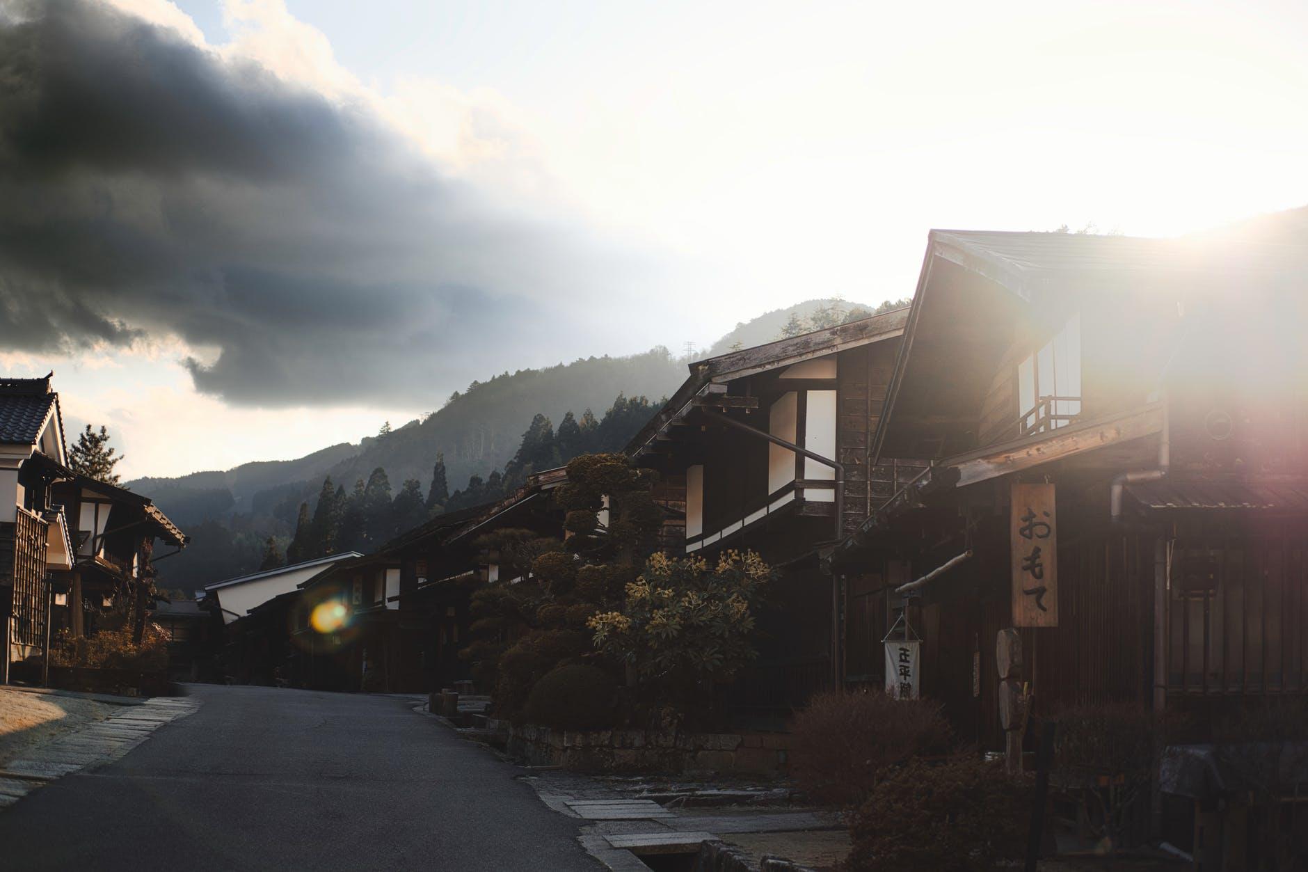 road between brown houses